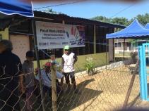 Volunteers outside PMM